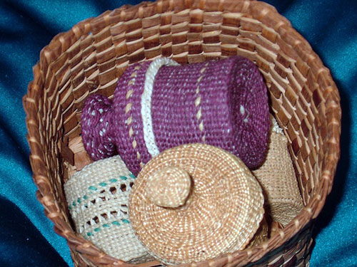 A variety of native woven baskets in various colors and patterns