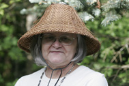 Artist Lois Thadei is pictured wearing a traditional woven hat