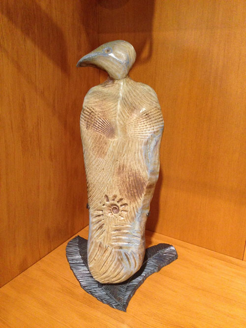Hand-carved native artist Lillian Pitt's rendering of a bird is covered in intricate designs.