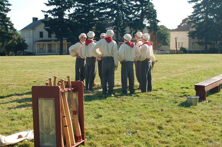 Boys play vintage baseball at Fort Vancouver in costume