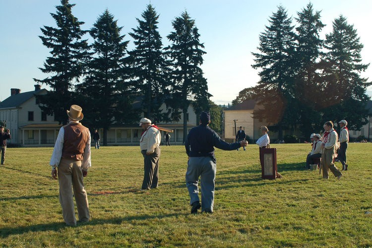 Base ball played in period costume by members of the Vintage Baseball Association on the green at Fort Vancouver National Historic Site.