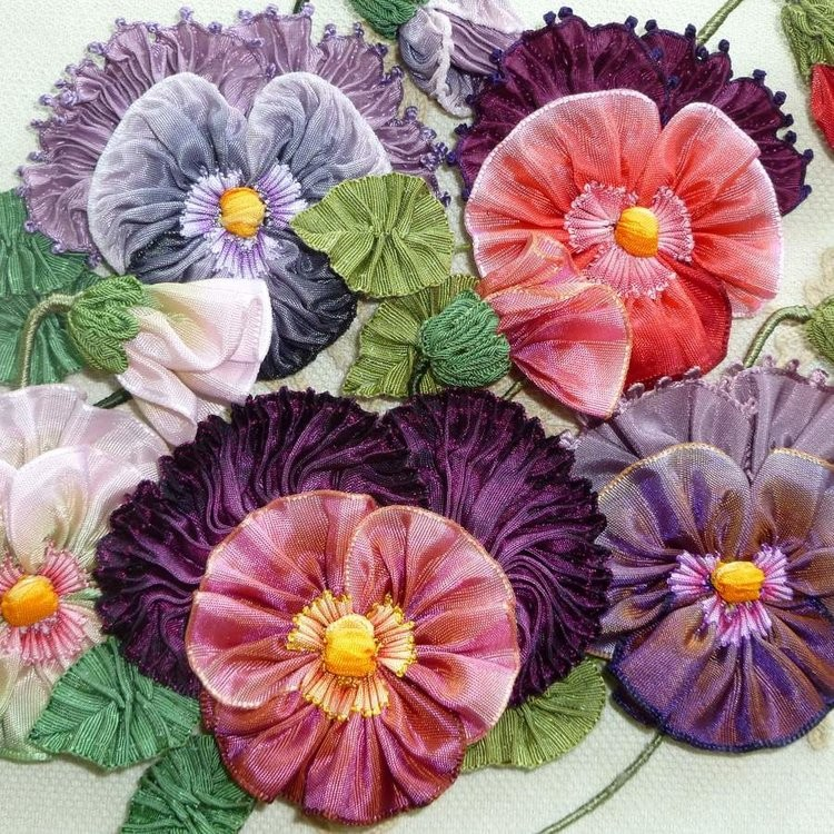 Beautiful ribbon flowers and leaves decorate hats and costumes.